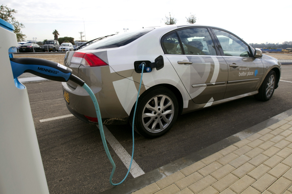 An electric car rechrages its battery from a stand at the parking of Better Place, a electric vehicle services provider, in Glilot north of Tel Aviv on January 17, 2011.