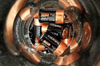 File photo: A plastic tube contains batteries for recycling inside a Staples store September 29, 2005 in Mount Prospect, Illinois.
