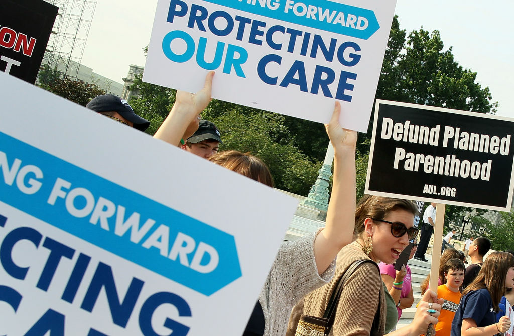 People for and against the administrations health care act protest in front of he U.S. Supreme Court, on June 28, 2012 in Washington, DC.