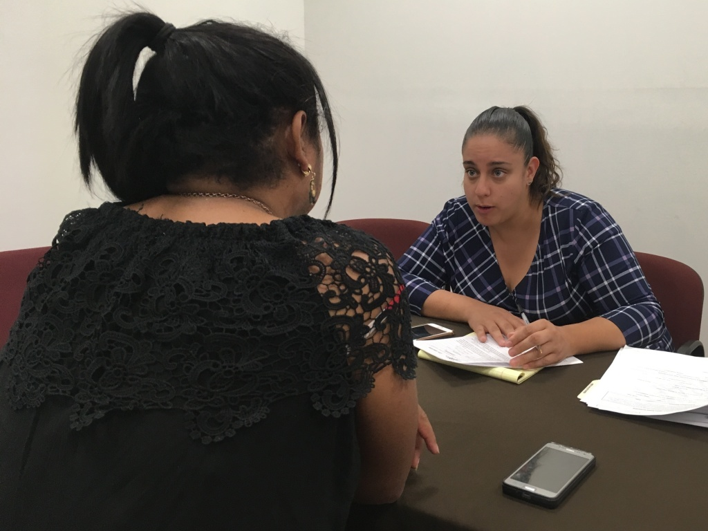 Attorney Linda Rivas with the nonprofit Las Americas of El Paso meets with transgender migrant woman sent back to Mexico as part of the Trump administration's