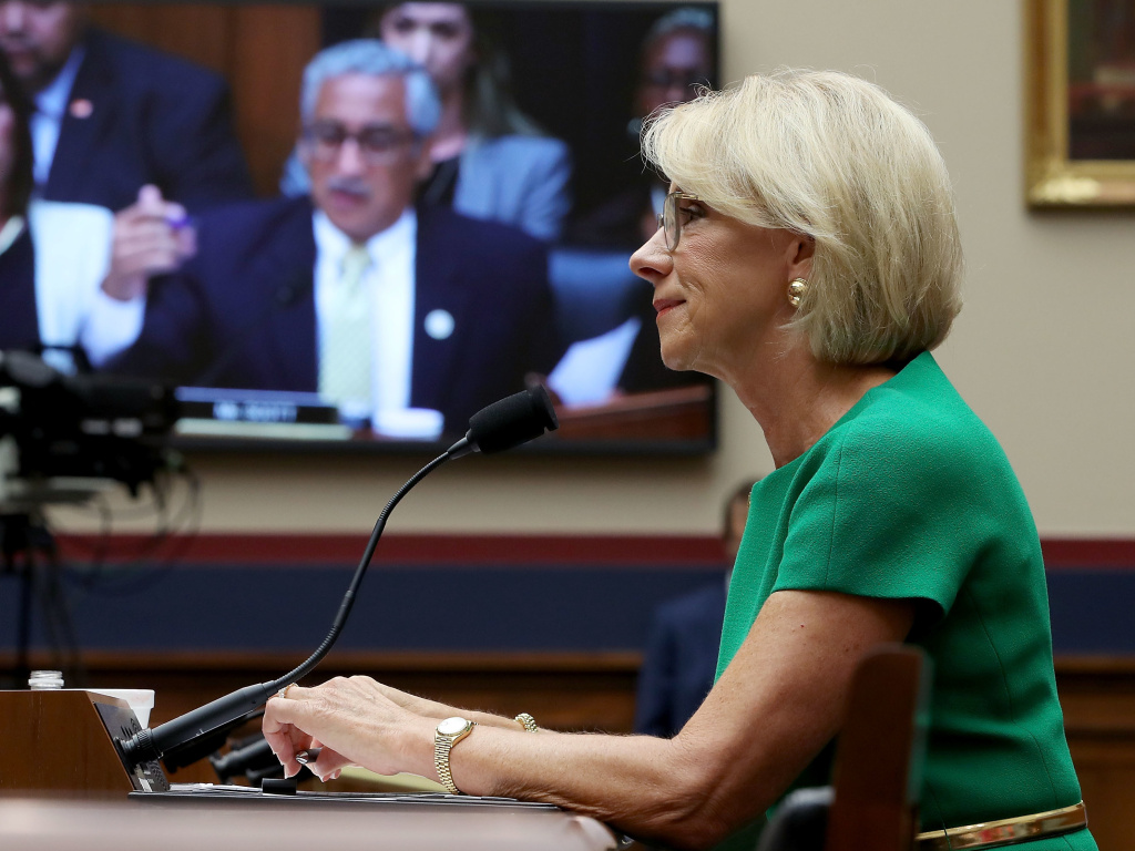 Education Secretary Betsy DeVos answers questions by Rep. Bobby Scott, D-Va.,(on video screen) during a House House Education and the Workforce Committee hearing on Capitol Hill.