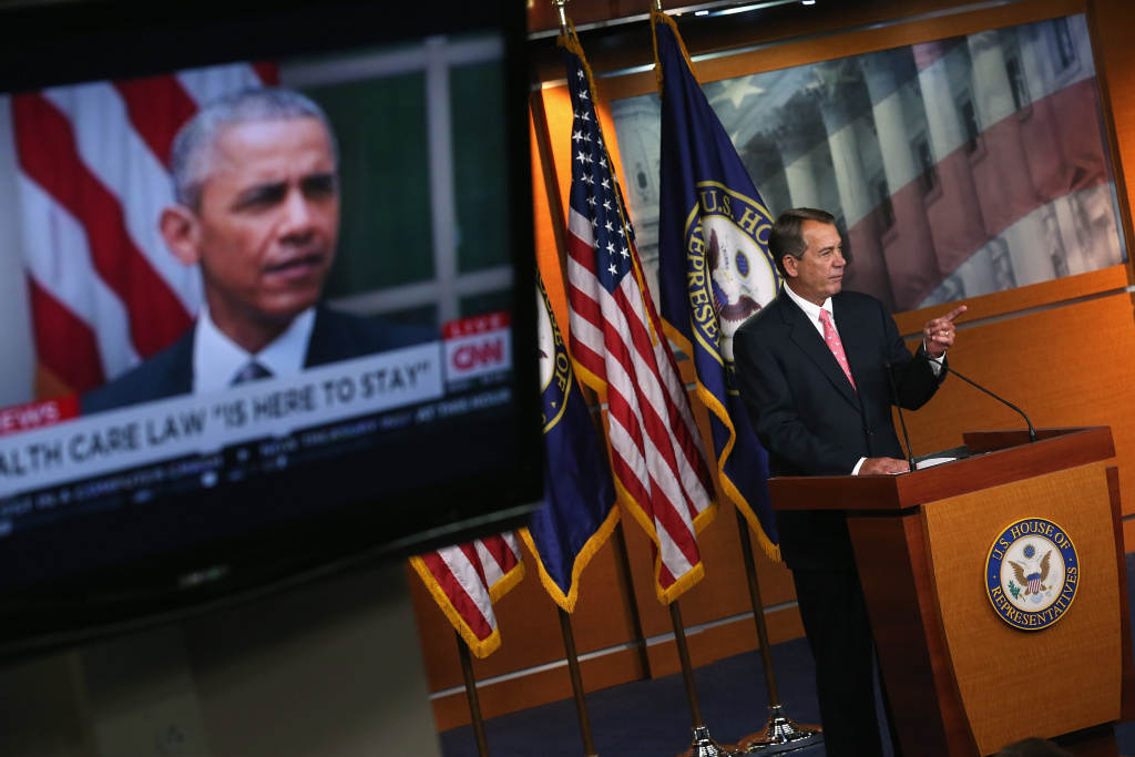 Speaker of the House John Boehner (R-OH) (R) holds his weekly news conference at the same time President Barack Obama appears on television to make a statement about the Supreme Court ruling on Obamacare at the U.S. Capitol June 25, 2015 in Washington, DC.