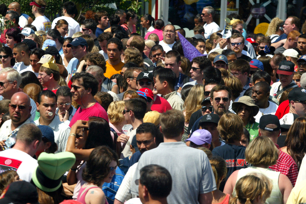 Crowds gather outside the re-launch ceremony of Disneyland's Space Mountain attraction at Disneyland on July 15, 2005.