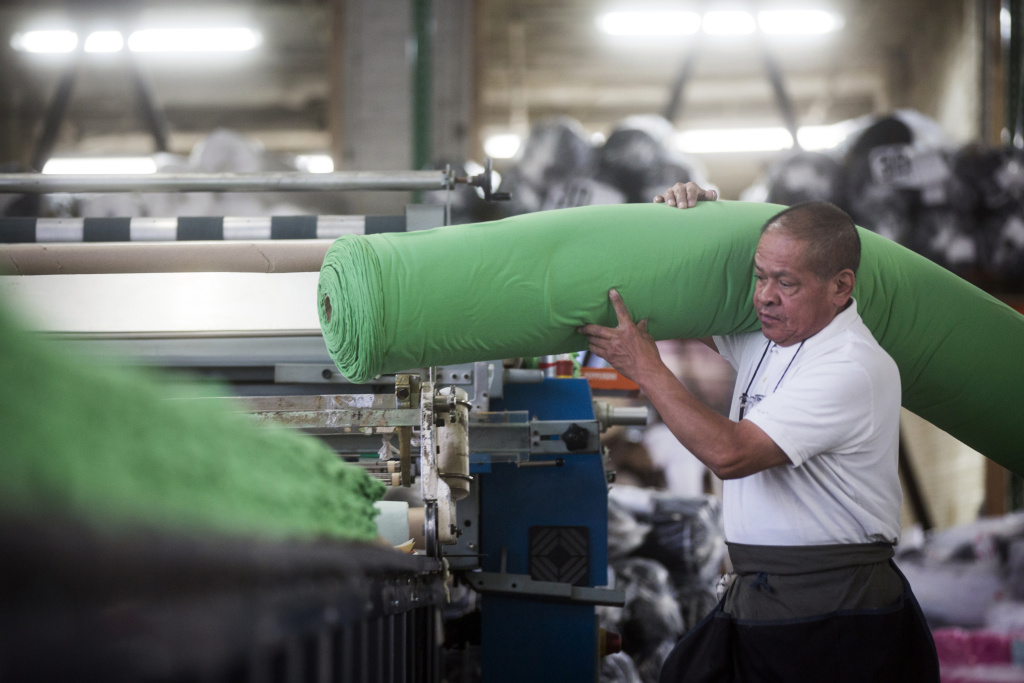 Antonio Napoles prepares fabric for cutting at Los Angeles Apparel's factory.