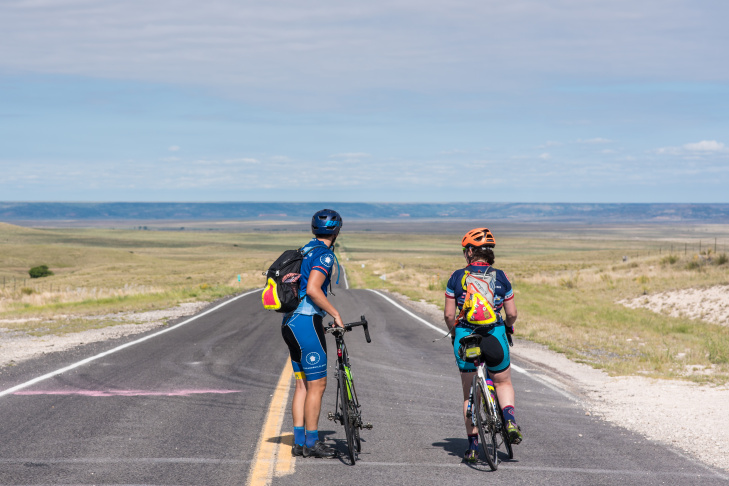 Bike and Build cyclist Sean Triser celebrates after entering California. Photo Credit: Marlee Dunbar