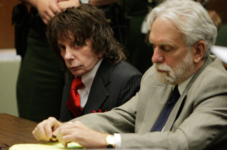 Phil Spector (L) listens to the judge during sentencing in Los Angeles Criminal Courts on May 29, 2009 in Los Angeles, Californial, for the February 2003 shooting death of actress Lana Clarkson. Spector was sentenced for 19-years to life.