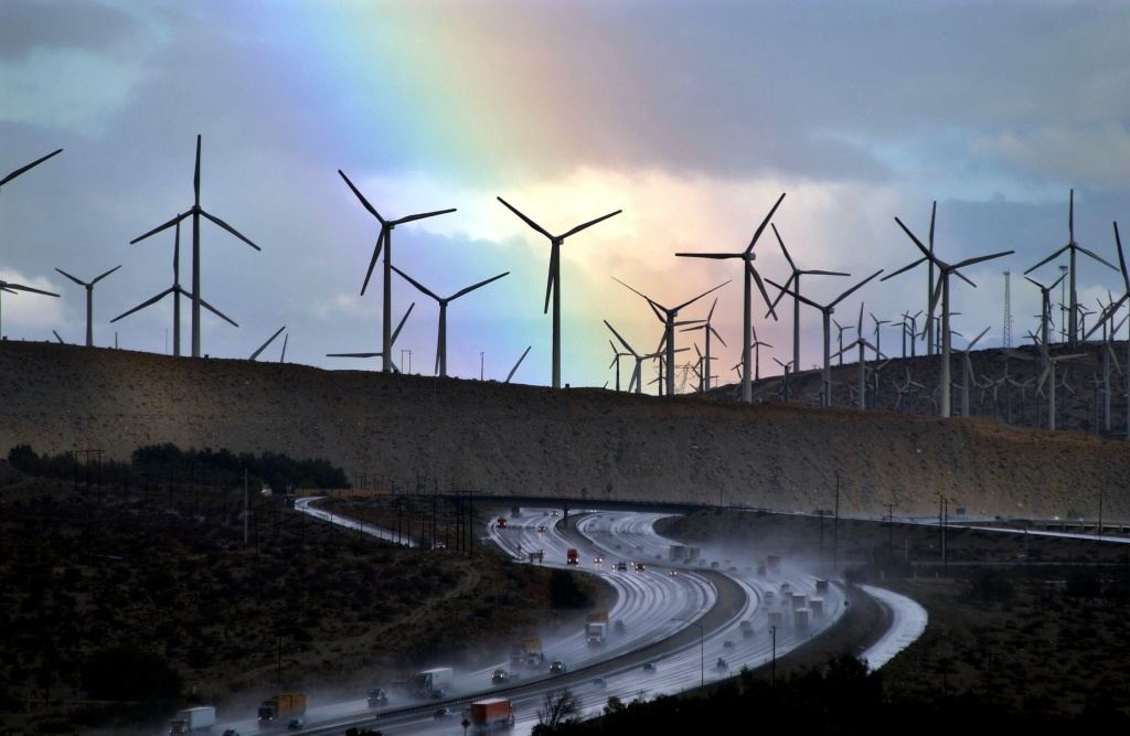 A rainbow forms behind giant windmills near rain-soaked Interstate 10 as an El Nino-influenced storm passes over the state on December 17, 2002 near Palm Springs, California.