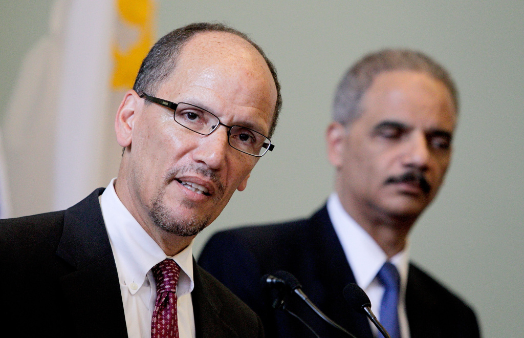 Assistant Attorney General for the Civil Rights Division Thomas E. Perez (L) discusses  the Federal Consent Decree with Attorney General Eric Holder at Gallier Hall on July 24, 2012 in New Orleans, Louisiana. The signing of the federal consent decree was designed to clean up a police force that had been plagued by decades of corruption and abuse.