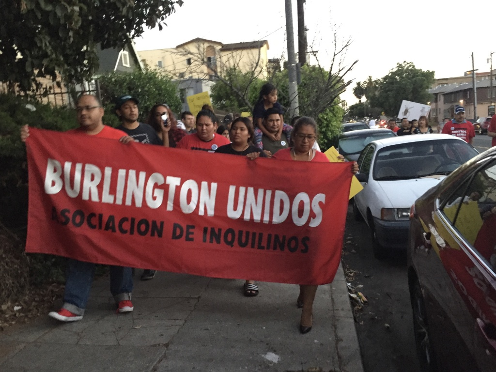Striking tenants in Westlake march through their neighborhood in late July (Matt Tinoco/SCPR)