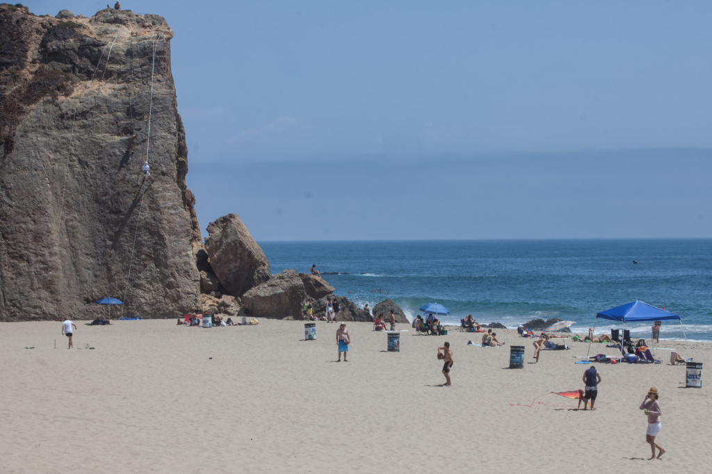 Beachgoers relax at Point Dume in Malibu on July 9, 2013.
