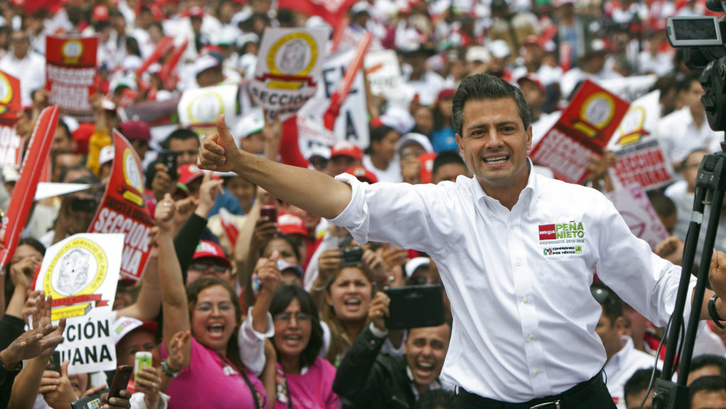 Enrique Pena Nieto of the Institutional Revolutionary Party, or PRI, waves to the crowds in the northern border city of Tijuana, Mexico, on June 3.