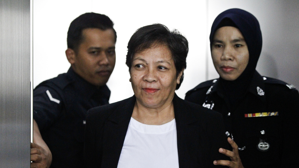 Maria Elvira Pinto Exposto was escorted by police during a court hearing in Malaysia in December, where she was exonerated of drug smuggling charges. On Thursday an appeals court overturned the ruling and sentenced her to die by hanging.