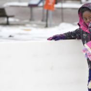 Brooklyn Hill, 3, got help from 10-year-old Thalia Epps on Tuesday as they skated in Ann Arbor, Mich. From the upper Midwest through New England, more bitter cold and stormy weather is expected in coming days.