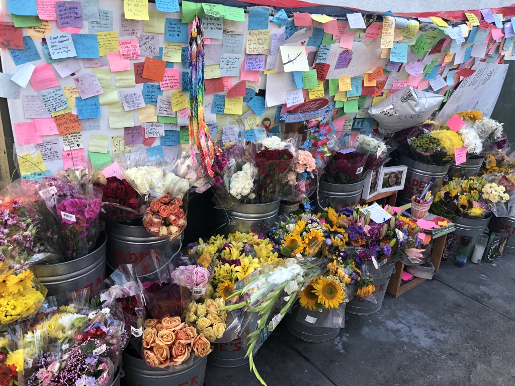 A memorial for Melyda Corado, the Trader Joe's store manager who was struck and killed by LAPD gunfire, outside the store on August 2, 2018.