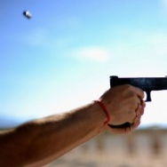 People shoot their guns at a shooting range near the Crossroads of the West Gun Show.