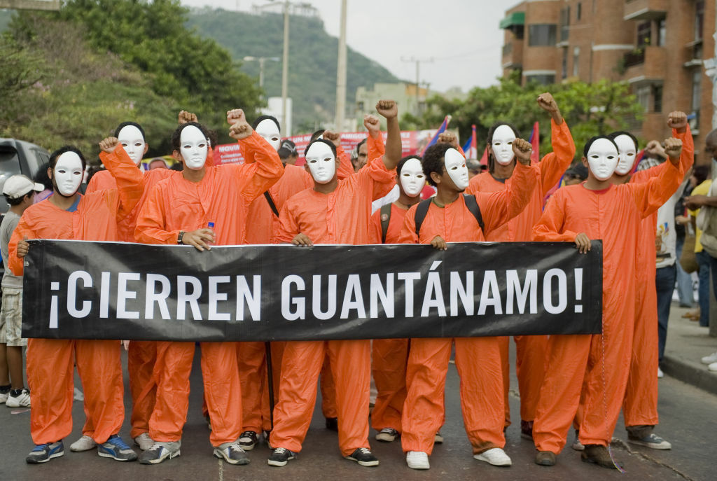 Members of social organizations protest against the VI Summit of the Americas in Cartagena de Indias, Colombia and demand the closing of US prison in Guantanamo on April 14, 2012.