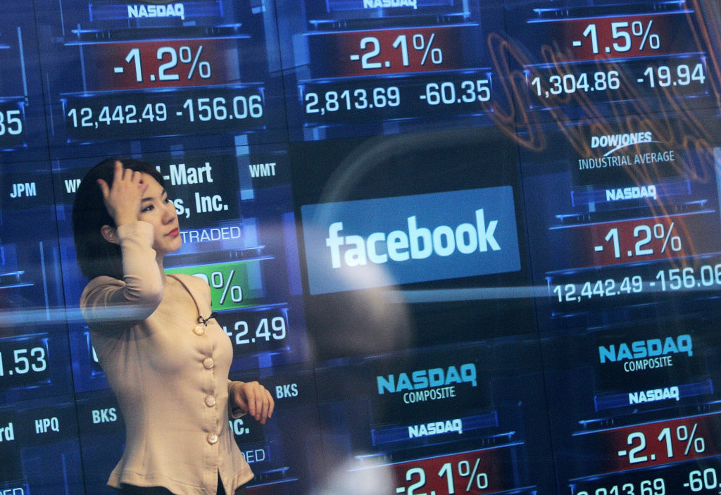 A Nasdaq television reporter is seen inside the Nasdaq studios as the Facebook logo is displayed on a ticker board on May 17, 2012 in New York City. Facebook will list their IPO on Nasdaq on Friday morning with an opening price of $38 per share.