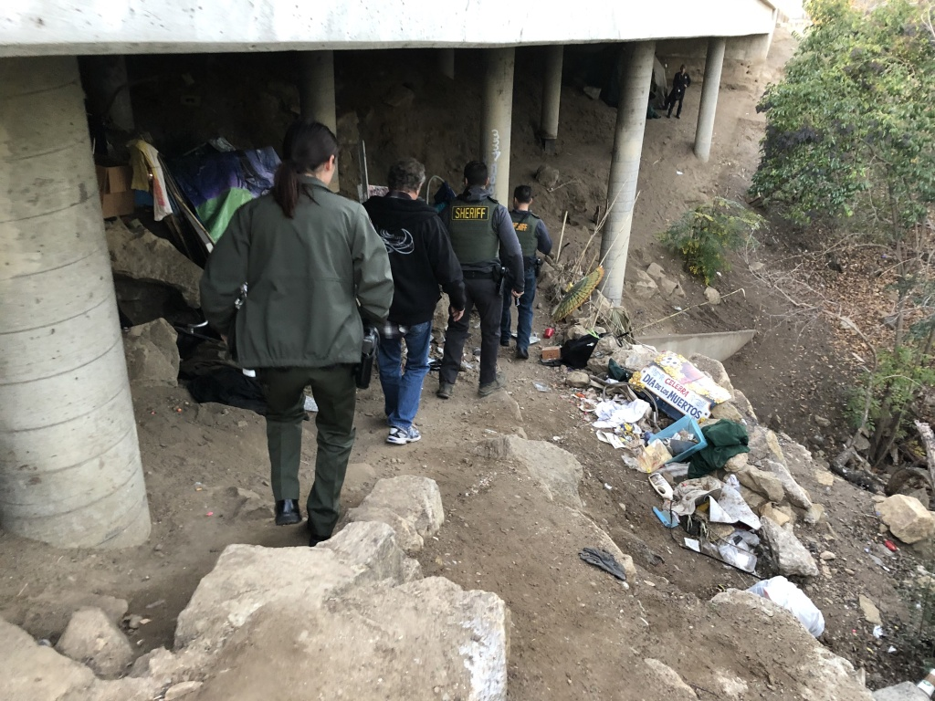 Ventura County Sheriff Deputies conduct the annual homeless survey near tent encampments in the Thousand Oaks region.