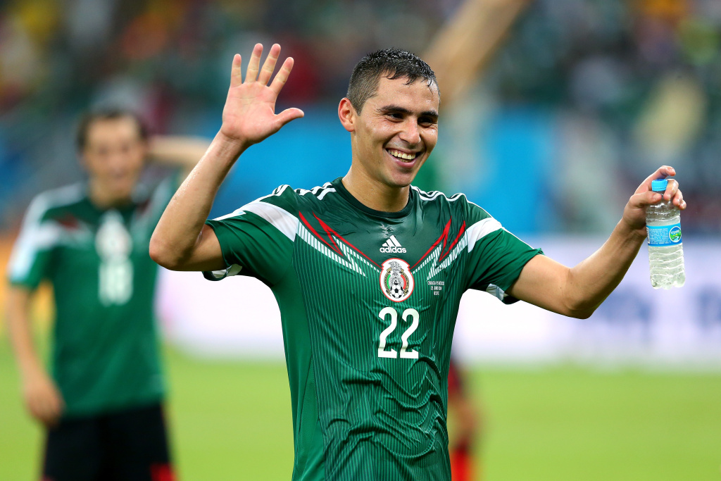 Paul Aguilar of Mexico celebrates after winning the 2014 FIFA World Cup Brazil Group A match between Croatia and Mexico at Arena Pernambuco on June 23, 2014 in Recife, Brazil.