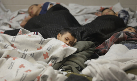 Child detainees sleep in a holding cell at a U.S. Customs and Border Protection processing facility in Brownsville,Texas. According to a new analysis of government data, the share of unaccompanied minor children 12 and younger arriving at the U.S.-Mexico border has jumped from 9 percent in 2013 to 16 percent this year so far.