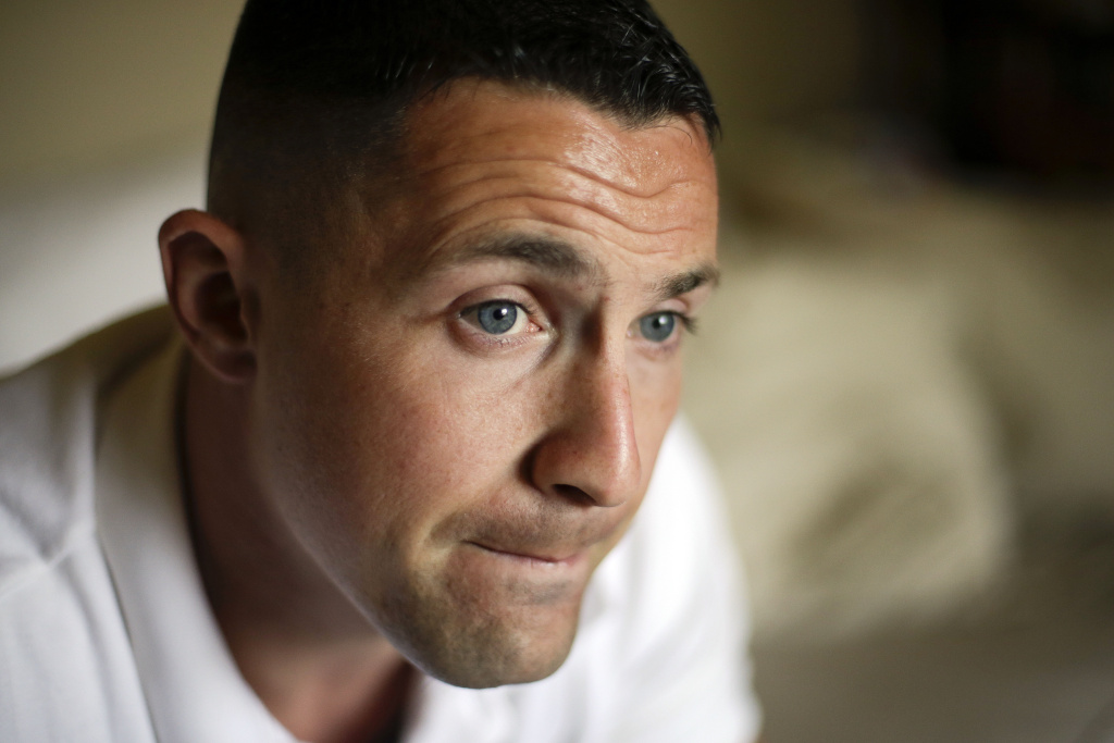 Marine Sgt. Lawrence Hutchins III speaks at his home in Oceanside, California on August 2, 2013. A military jury found Hutchins guilty of murder Wednesday in the retrial of a major Iraq war-crimes case involving the 2006 killing of a retired Iraqi policeman.