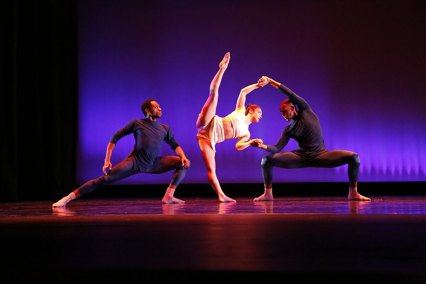 Contemporary dancers on stage with the company BrockusRED