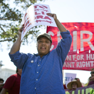 An immigration reform supporter rallies in Los Angeles on Wednesday, Aug. 27. White House officials announced over the weekend that President Obama will delay taking executive action on immigration until after the midterms, a move that's prompted an angry reaction from immigrant advocates.