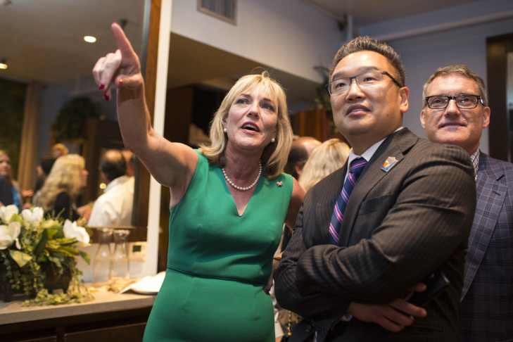 Los Angeles County Supervisor District 5 candidate Kathryn Barger watches election coverage with Mayor of Duarte Sam Kang during Barger's election party at Sorriso in Pasadena on Tuesday night, June 7, 2016 during the California primary.