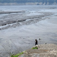 This picture taken on March 20, 2015 shows a tourist walking at Shihman dam in northern Taoyuan.  Taiwan launched water rationing in some major cities as the island battled its worst drought in over a decade, following the lowest rainfall in nearly 70 years.