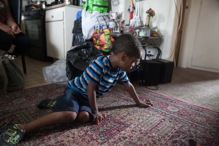 Delroy Haughton, 4, Plays On The Carpet At His Home In South Los Angeles