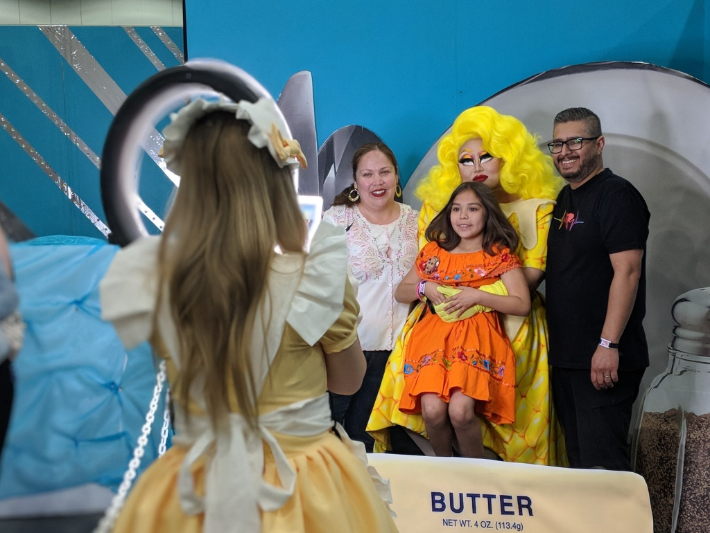 Drag queen Kim Chi, in yellow, poses with her fans during RuPaul's DragCon LA 2018. Parents Lorena Garcia-Marquez (L) and Roberto Marquez (R) brought their 8-yo Sophie Marquez to the event.