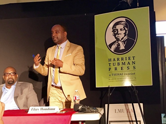 Elias Wondimu announces Harriet Tubman Press at an event at a community discussion of African-American publishing at the Vision Theater in Leimert Park on Monday, Aug. 15, 2016.