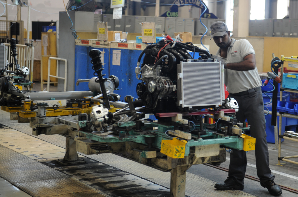 Indian workers on assembly lines for Datsun Go and Renault Kwid vehicles at Renault Nissan Automotive India factory in Chennai.