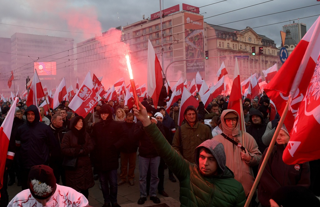 Demonstrators burn flares and wave Polish flags during the annual march to commemorate Poland's National Independence Day in Warsaw on November 11, 2017.  Poland's National Independence Day commemorates the anniversary of the Restoration of a Polish State in 1918. / AFP PHOTO / JANEK SKARZYNSKI        (Photo credit should read JANEK SKARZYNSKI/AFP/Getty Images)