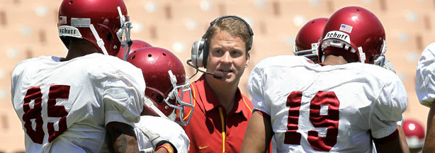 Head coach Lane Kiffin gives instructions in the offensive huddle during the USC Trojans spring game on May 1, 2010 at the Los Angeles Memorial Coliseum in Los Angeles, California.