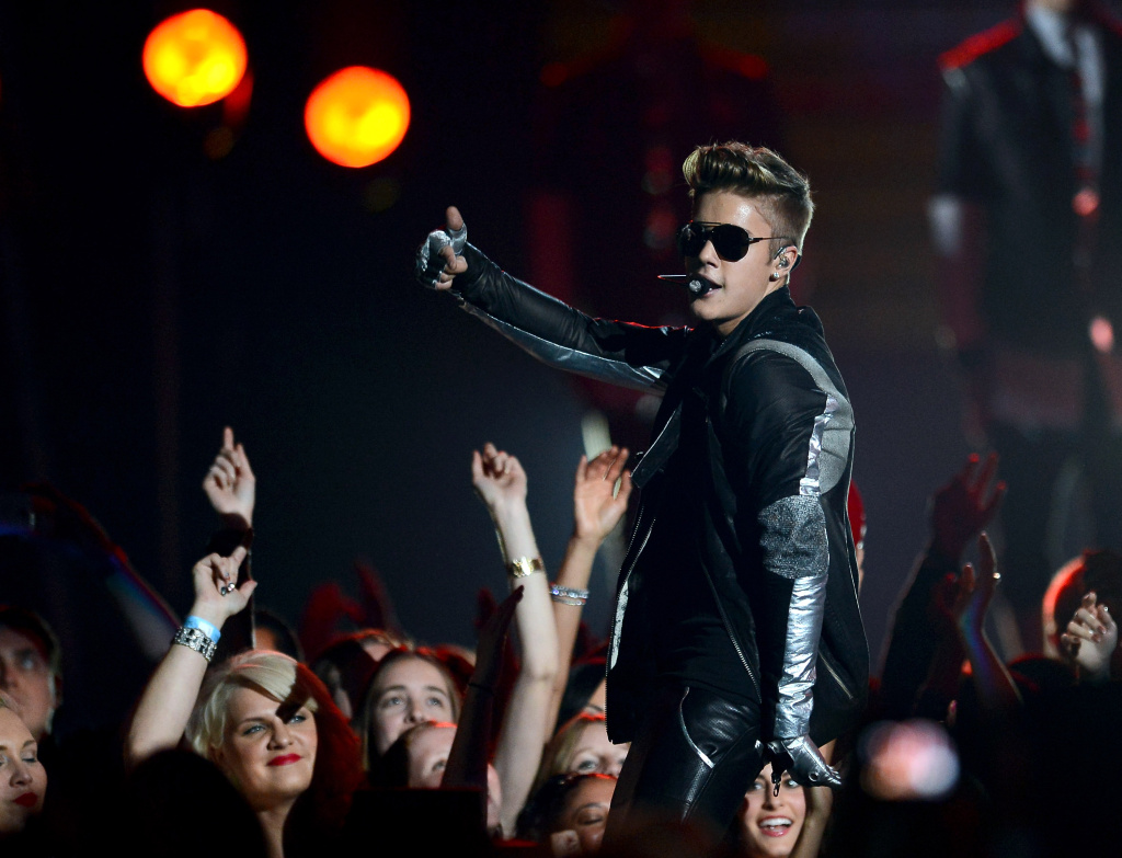 Singer Justin Bieber performs during the 2013 Billboard Music Awards at the MGM Grand Garden Arena on May 19, 2013 in Las Vegas, Nevada.