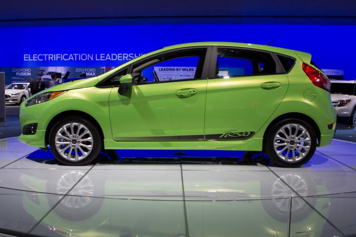 Ford's redesigned 2014 Fiesta at the LA Auto Show. There a 3-cylinder engine under that snout. That's right, a 3-cylinder engine.