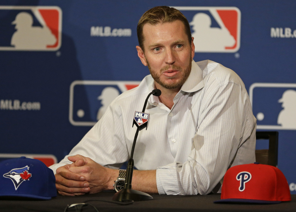 In this Dec. 9, 2013, file photo, two-time Cy Young Award winner Roy Halladay answers questions after announcing his retirement after 16 seasons in the major leagues with Toronto and Philadelphia at the MLB winter meetings in Lake Buena Vista, Fla. Authorities have confirmed that former Major League Baseball pitcher Roy Halladay died in a small plane crash in the Gulf of Mexico off the coast of Florida, Tuesday, Nov. 7, 2017.
