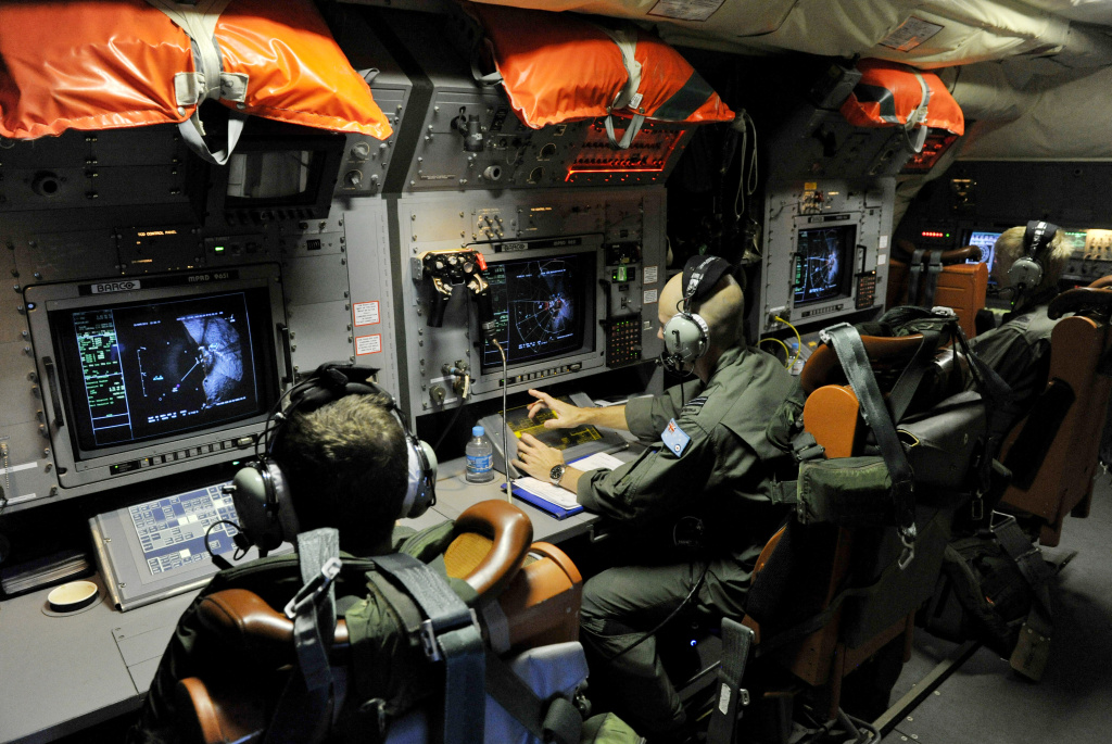 Flight Leuitenant Neville (Smokey) Dawson on board a Royal Australian Airforce AP-3C Orion from Pearce Airforce Base during a search mission for possible MH370 debris on March 21, 2014 in Perth, Australia. Australian authorities yesterday received satellite imagery that shows two large objects in the Indian Ocean that may be debris from missing Malaysian Airlines flight MH370. The airliner went missing nearly two weeks ago carrying 239 passengers and crew on route from Kuala Lumpur to Beijing.