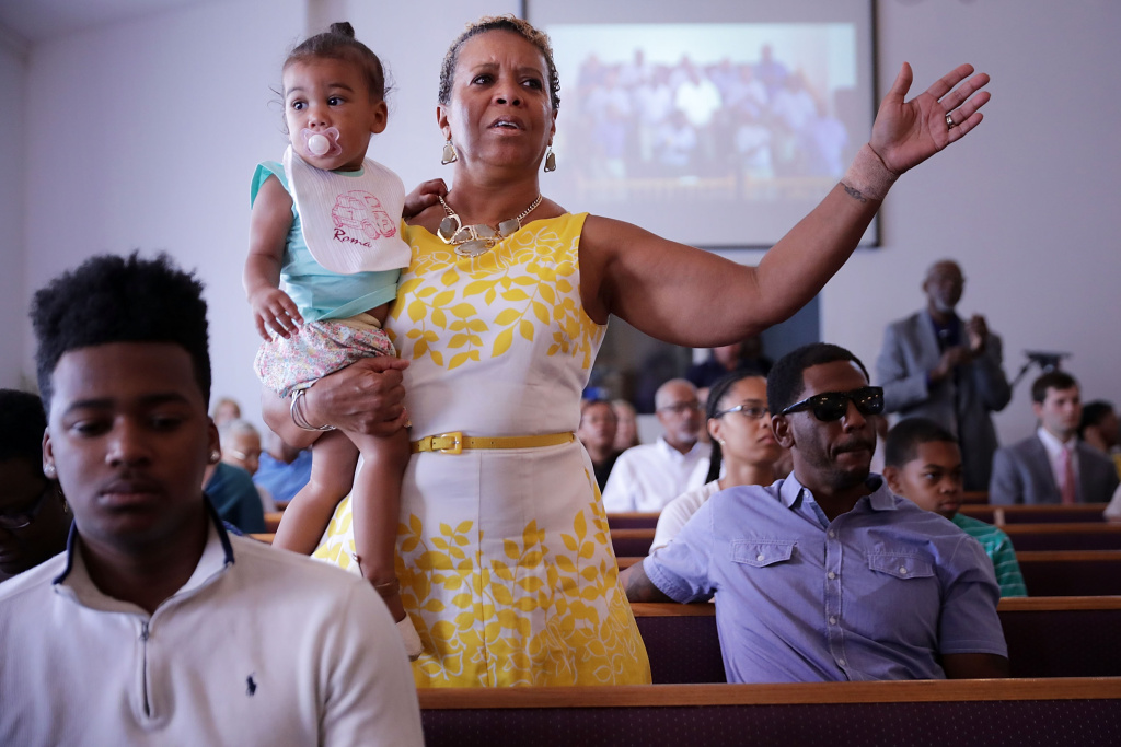 Worshippers sing and pray during a service at Mt. Zion First African Baptist Church on August 13, 2017 in Charlottesville, Virginia. Virginia Gov. Terry McAuliffe addressed the congregation the day after violence erupted around a rally of white supremacists.