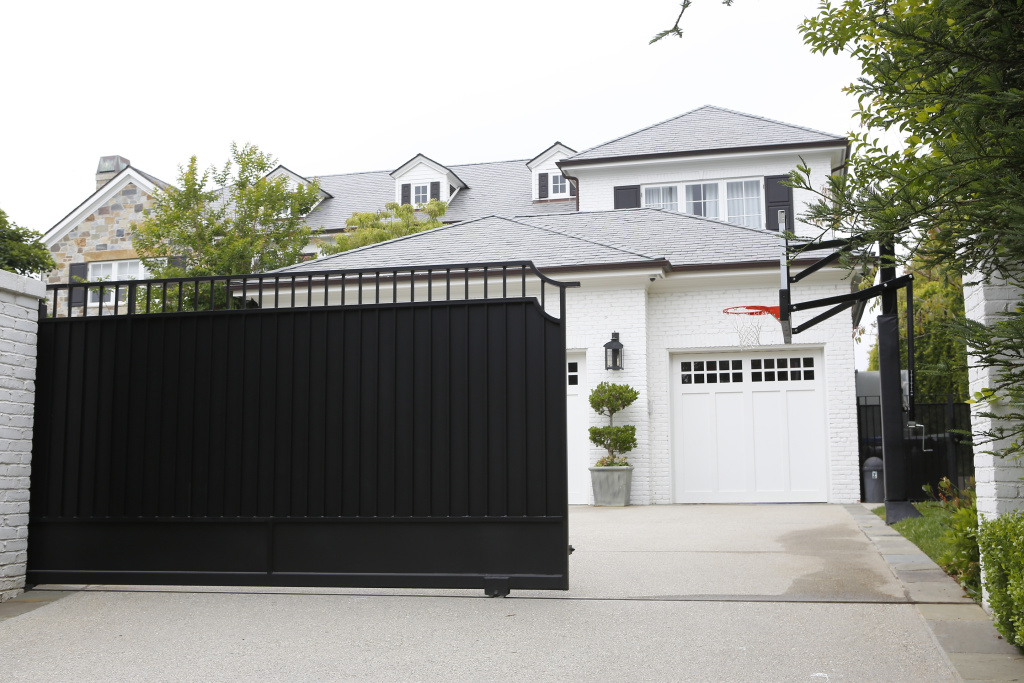The front gate of a home belonging to Cleveland Cavaliers' LeBron James is freshly repainted Wednesday, May 31, 2017, in Los Angeles. Police are investigating after someone spray painted a racial slur on the front gate of James' home in Los Angeles on the eve of the NBA Finals.