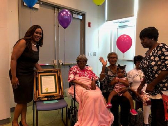Hester Ford, center, celebrates her birthday in 2019 with her family members. Ford died last Saturday at 115 or 116.