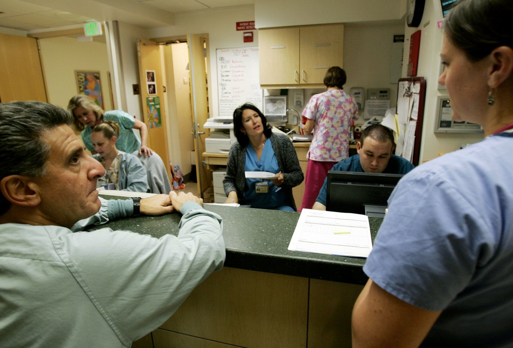 Dr. Stephen DiMarzo (L) and nurses go over work details in the maternity ward at Scripps Memorial Hospital on January 9, 2007 in La Jolla, California.