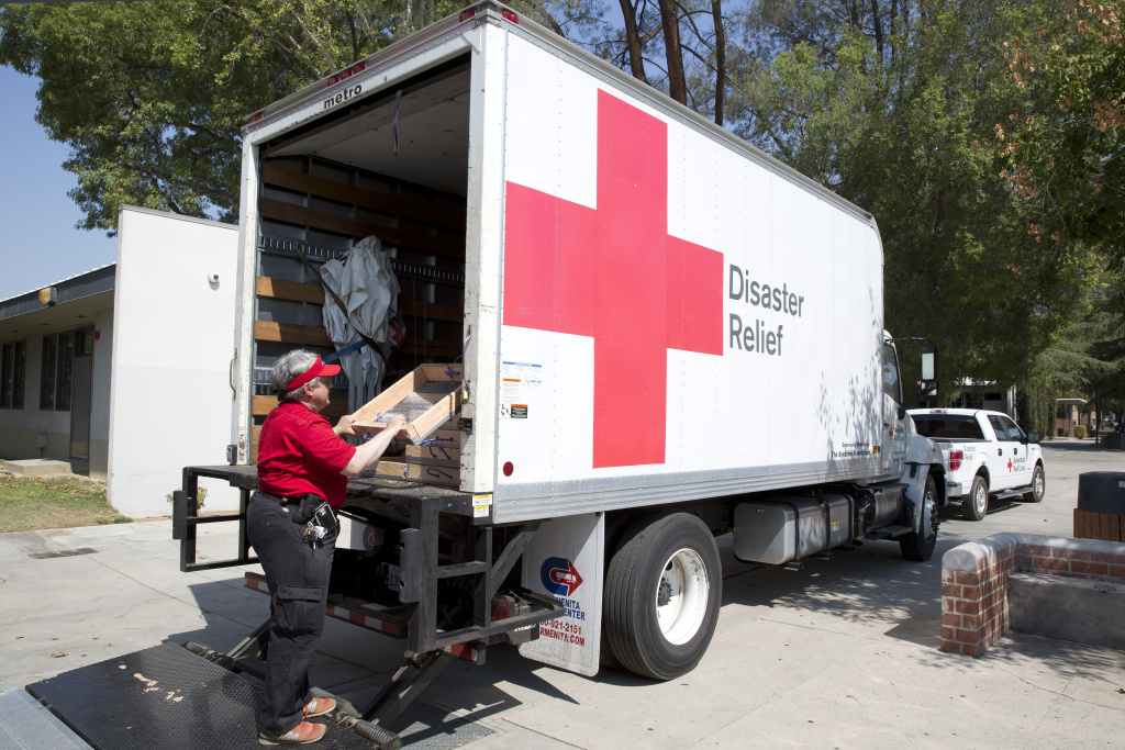 File: A volunteer with the American Red Cross loads a sifter onto a truck at the temporary shelter set up in the Hart High School in Santa Clarita on July 29th 2016.