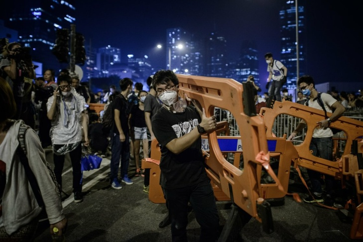 Pro-democracy protesters set up barricades in Hong Kong