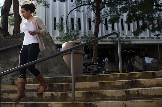Gabrielle Dewberry runs to class with her assignment in hand at Cal State-Fullerton.