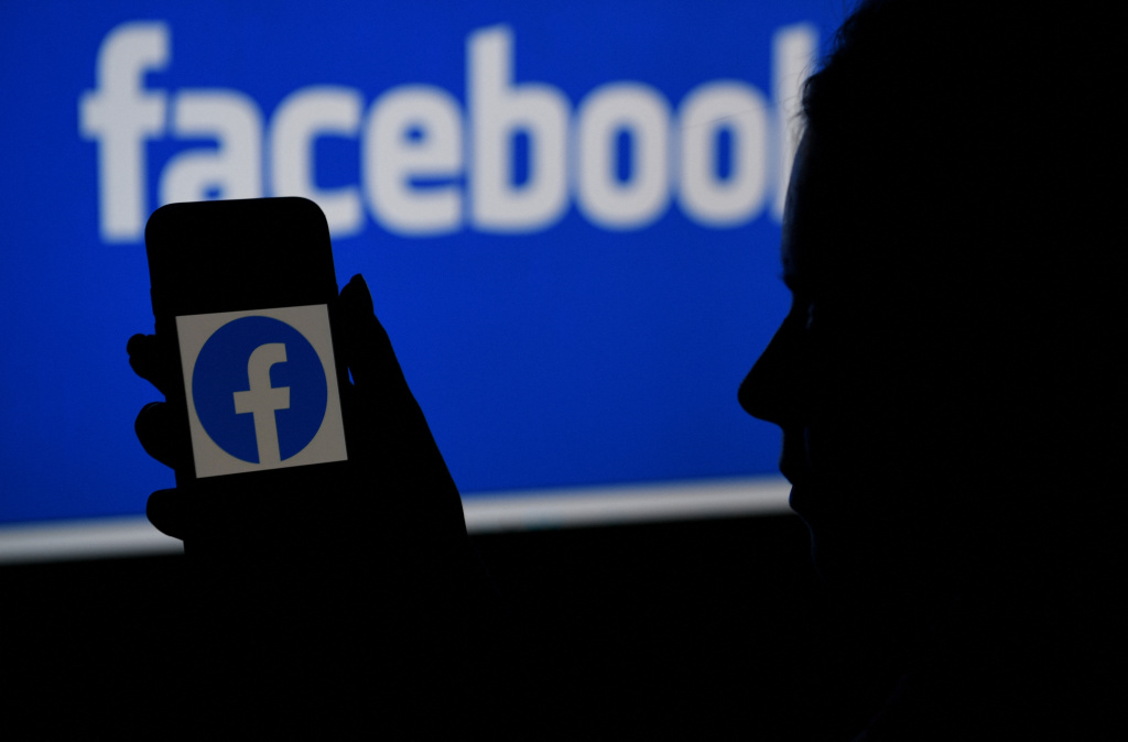 In this photo illustration, a smart phone screen displays the logo of Facebook on a Facebook website background, on April 7, 2021, in Arlington, Virginia.