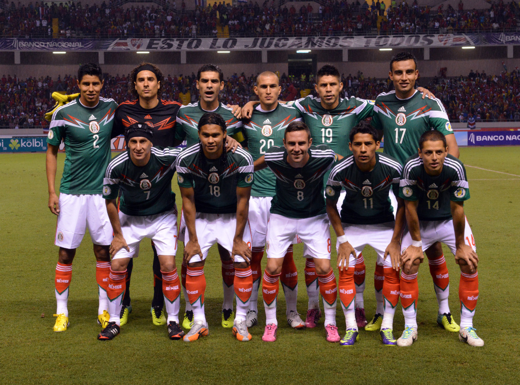 The Mexican national football team poses for pictures before their Brazil 2014 FIFA World Cup Concacaf qualifier match against Costa Rica, at the National stadium in San Jose, on October 15, 2013. (Standing L-R) Footballers Hugo Ayala, Guillermo Ochoa, Rafael Marquez, Jorge Torres, Uribe Peralta and Jesus Zavala. (Front row, L-R) Cristian Jimenez, Carlos Peña, Miguel Layun, Javier Aquino and Javier Hernandez.