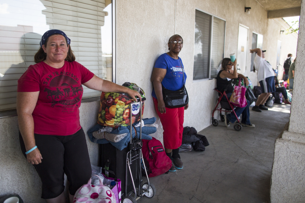 Victoria Burton waits in line to get a bed for the night at Grace Resource Center's Lancaster Community Homeless Shelter on Tuesday afternoon, May 31, 2016. Burton, a U.S. Navy veteran, is originally from Australia. She has been homeless once before, for more than a year in Oklahoma.