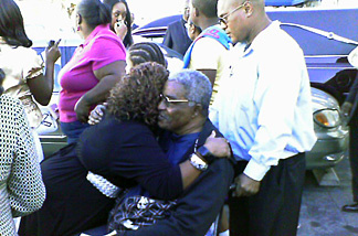 Family members of 5 year-old Aaron Shannon Jr. comfort each other after funeral services at City of Refuge church in Gardena.